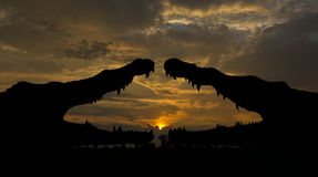 Silhouette two crocodiles in the morning. Royalty Free Stock Photos