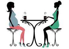 Silhouette of two fashionable women Stock Photography
