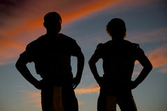 Silhouette of two football players close Royalty Free Stock Images