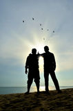 Silhouette of two friends Royalty Free Stock Photo