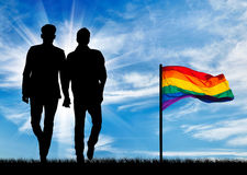 Silhouette of two gay men stock image