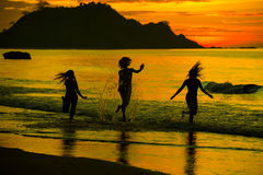 Silhouette of two girls at sunset Stock Photography