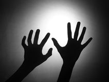 Silhouette of two hands Royalty Free Stock Images