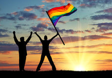 Silhouette of two happy gays Stock Photos