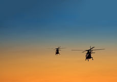 Silhouette of two helicopters Royalty Free Stock Photos