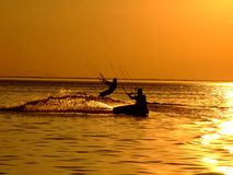 Silhouette of a two kitesurf. On a gulf on a sunset Stock Image