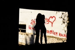 Silhouette of two little girls hugging. Silhouette of two seven year old little girls hugging royalty free stock image