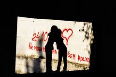 Silhouette of two little girls hugging. Silhouette of two seven year old little girls hugging royalty free stock images