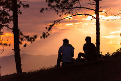 Silhouette of two man. Silhoette of two man at Doi hom Pok,Chiang Mai ,Thailand Royalty Free Stock Image