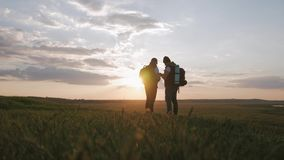 The Silhouette of two man on the top of mountain with Backpacks and other Gear expressing Energy and Happiness. Two stock footage