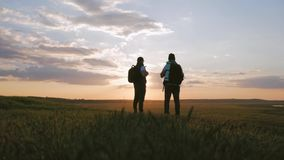 The Silhouette of two man on the top of mountain with Backpacks and other Gear expressing Energy and Happiness. Two stock video footage