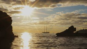 Silhouette two-masted yacht at the beautiful sunset on the sea. Mallorca island, Spain stock footage
