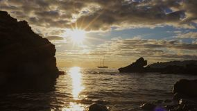 Silhouette two-masted yacht at the beautiful sunset on the sea. Mallorca island, Spain stock video footage