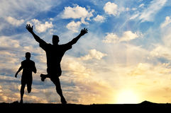 Silhouette of two men running competition Royalty Free Stock Image
