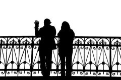 Silhouette of two people on the bridge with a fencing Royalty Free Stock Images