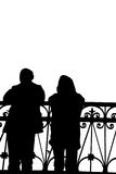 Silhouette of two people on the bridge with a fencing Royalty Free Stock Photography