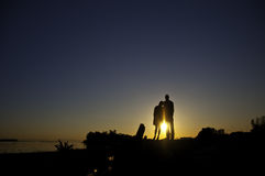 Silhouette of two people standing on a bank Royalty Free Stock Photos