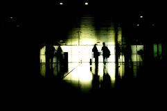 Silhouette of two people traveling. A dark scene with traveling people Stock Photo