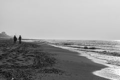 Silhouette of two people walking. On the beach of the town Zandvoort Netherlands Stock Photography