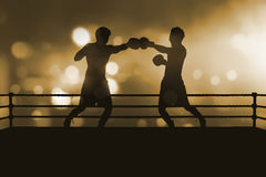 Silhouette of two professional asian boxer fight in the boxing m Stock Photos
