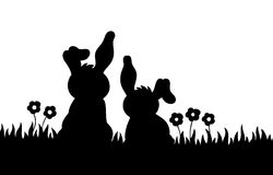 Silhouette of two rabbits on meadow Stock Photography
