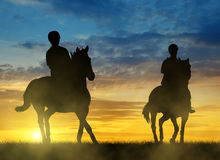 Silhouette two riders on horse Royalty Free Stock Photo