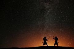 Silhouette of two samurais against the starry sky. royalty free stock photo