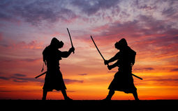 Silhouette of two samurais in duel. Stock Photo