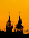 Silhouette of two towers of Church of Our Lady before Tyn in morning Prague, Czech Republic. Contrast black controur and Royalty Free Stock Photography