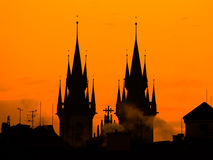 Silhouette of two towers of Church of Our Lady before Tyn in morning Prague, Czech Republic. Contrast black controur and Stock Image