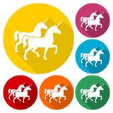 Silhouette of Two Unicorn Horse icons set with long shadow. Vector icon Stock Photos