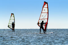 Silhouette of a two windsurfers royalty free stock photo