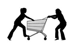 Silhouette of two women fighting for a shopping caddy. Silhouette of two young women crazy about shopping trying to monopolize a shopping caddy Royalty Free Stock Images