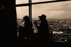 Silhouette of Two Women Singing in Sepia Photography Stock Image