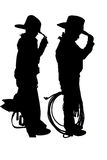 Silhouette of two young cowboys. Two young cowboys holding rope and saddle royalty free stock photography