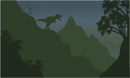 Silhouette of tyrannosaurus in cliff Royalty Free Stock Image