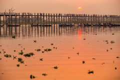 Silhouette of U Bein bridge at sunset Stock Photos