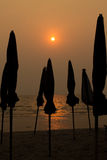 The silhouette of umbrella. On the Bangsean beach Thailand Stock Photography