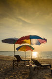Silhouette umbrella at the beach and sunset Royalty Free Stock Photography