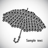 Silhouette of umbrella from the cat tracks Stock Photography