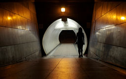 Silhouette of Undefined woman walking into the Underground walkway royalty free stock photography