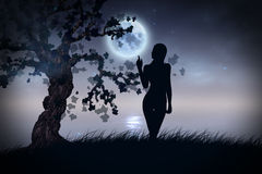 Silhouette under moon Royalty Free Stock Image