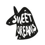 Silhouette of unicorn with lettering text Sweet Dreams. Vector sticker Stock Photos