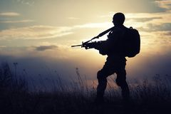 Silhouette of US marine. With rifle  against the sunset Stock Images