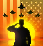 Silhouette of US soldier saluted. Silhouette of a soldier saluting the US flag on the background and the setting sun stock images