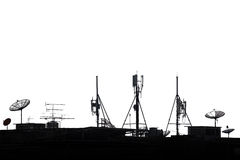 Silhouette various communication devices on rooftop on white background Stock Photography