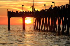 Silhouette of Venice pier at sunset stock photo