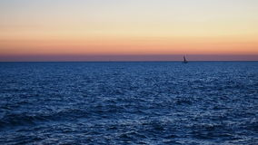 Silhouette vessel navigating sunrise sunset. Silhouette of vessel navigating at sunrise or sunset stock video