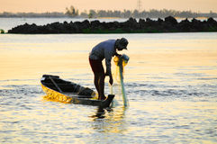 Silhouette of Vietnamese fisherman pulling a fishing net Stock Images