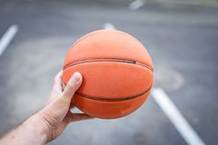 Silhouette view of a basketball player holding basket ball stock photography